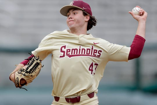 Florida State Seminoles pitcher Bryce Hubbart (43) throws during a rainy game between FSU and Niagara University Dick Howser Stadium Sunday, Feb. 16, 2020.