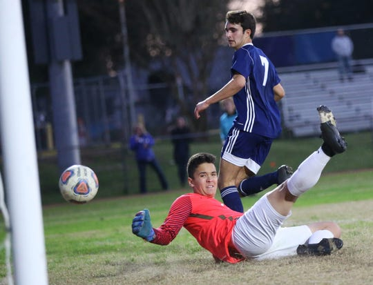 Maclay junior Mateus Bitencourt watches his shot go in for a goal as the Marauders' boys soccer team beat Lake Mary Prep 8-0 in a Region 1-2A semifinal on Feb. 15, 2020.