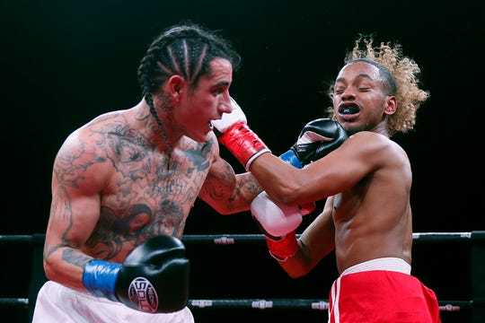 Boxers Joey Saenz and Eduardo Simmons fight Saturday, Feb. 15, at the El Paso County Coliseum. Saenz won by TKO.