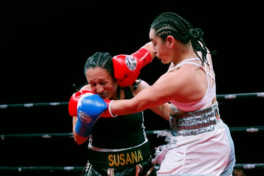 Boxers Ayanna Vasquez and Susana Uribe fight Saturday, Feb. 15, at the El Paso County Coliseum. Vasquez won by unanimous decision.