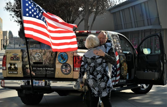 Debbie Tuttle hugs former El Diamante High School Prinicpal Mike Waters on Sunday, February 16, 2020.