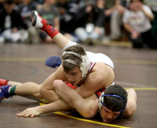 Tim Bova of Arlington defeated Tommy DellAera of Eastchester 6-0 to win the 138 pound championship during the Section 1 Division I wrestling championship at Clarkstown South High School Feb. 16, 2020. The win was Garcia's fourth straight sectional title.