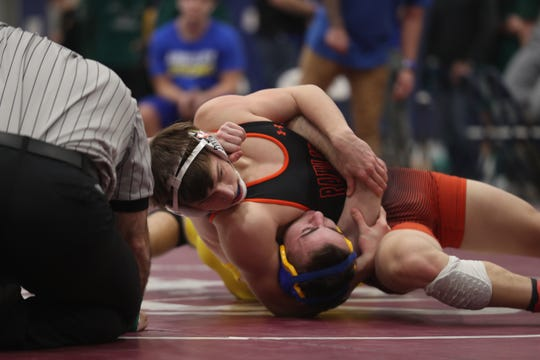 Pawling's Mason Watkins wrestles Ardsley's Josh Cohen in the 170-pound weight class during the Section 1 Division II championship at Purchase College Feb. 15, 2020. Pawling's Watkins won the match.