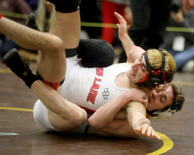 Dennis Robin of Arlington defeated Thomas Prisco of Fox Lane 15-0 to win the 152-pound championship during the Section 1 Division I wrestling championship at Clarkstown South High School on Feb. 16, 2020. The win was Garcia's fourth straight sectional title.