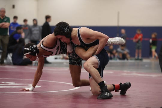 Our Lady of Lourdes Jackson Wainwright and Pleasantville's Nayshawn Marks  wrestle in the 113-pound weight class during the Section 1 Division II championship at Purchase College Feb. 15, 2020. Lourdes' Wainwright won the match.