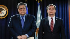 Attorney General William Barr and FBI Director Christopher Wray in Detroit on Dec. 18, 2019.