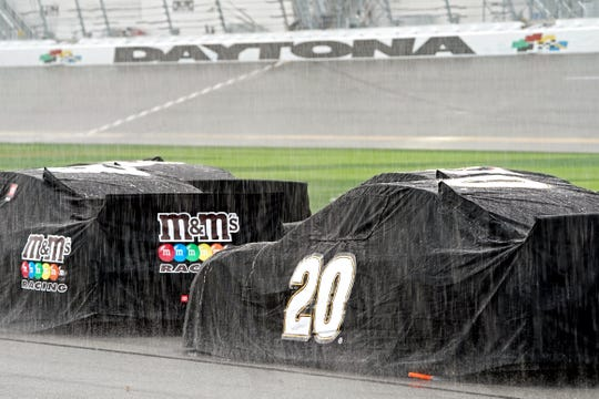 After drivers completed just 20 laps, Daytona International Speedway was hit with a downpour as cars were covered as the 2020 Daytona 500 was red-flagged.