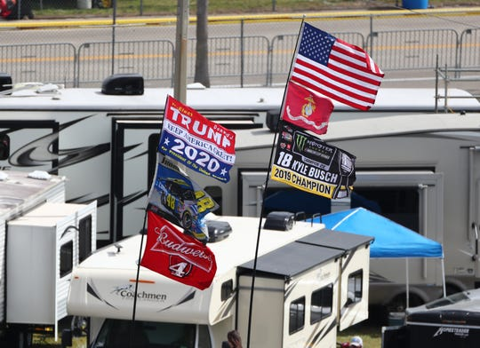 A Donald Trump re-election flag flies from a camper in the Daytona International Speedway infield ahead of the 2020 Daytona 500.