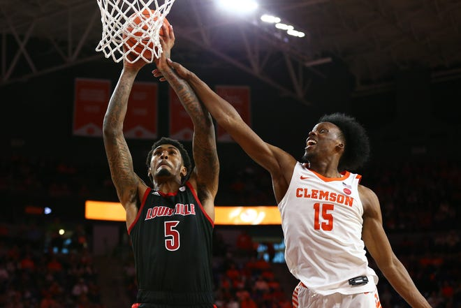 Clemson guard John Newman III (15) defends Louisville forward Malik Williams (5) during the second of the Tigers' 77-62 win.