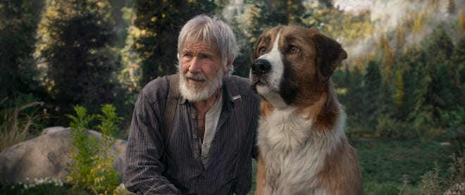 "John Thornton (Harrison Ford) makes fast friends with Buck in ""The Call of the Wild."""