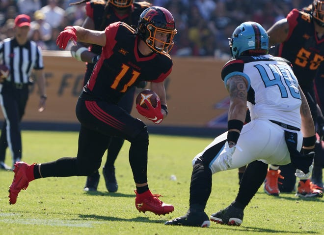 Los Angeles Wildcats receiver Nelson Spruce (11) tries to avoid Dallas Renegades linebacker Greer Martini defends during Sunday's XFL game at Dignity Health Sports Park in Carson. Spruce, a Westlake High graduate, scored two touchdowns in a 25-18 loss.