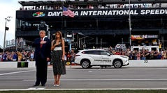 President Donald Trump with First Lady Melania Trump stand for the national anthem before the Daytona 500.