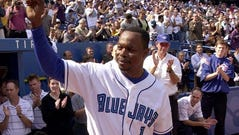 Tony Fernandez tips his cap as he takes the field for a pregame ceremony in Toronto on Sept. 23, 2001. He was honored by the Blue Jays as franchise's career leader in hits, doubles, triples, at-bats and games played.