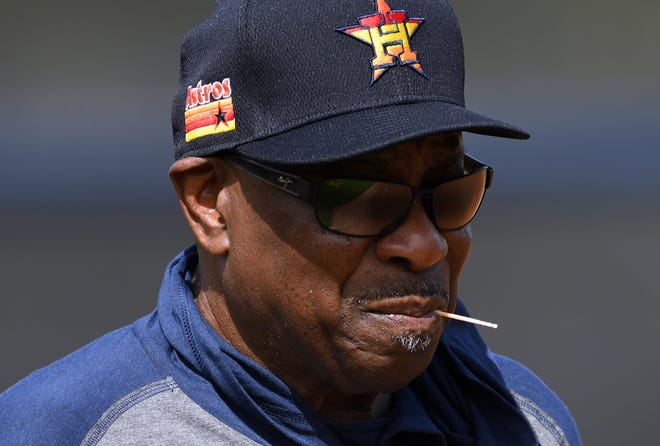 Feb. 13: Houston Astros manager Dusty Baker looks over his team during the morning spring training workout.