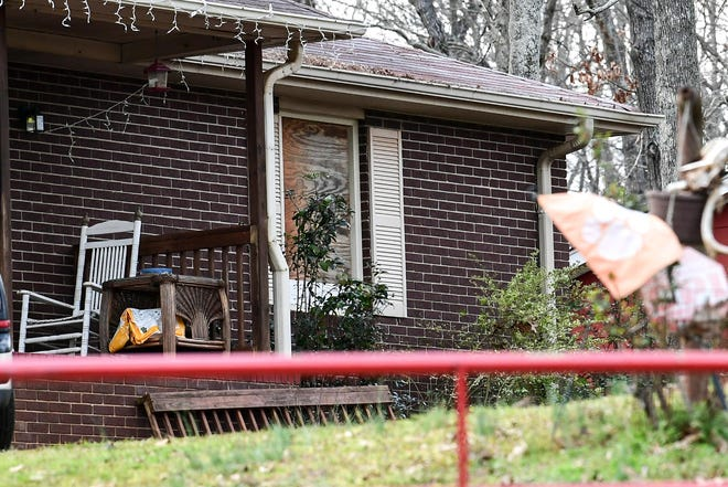 The window at a home on Rock Creek Road in Townville is boarded up after a fire Friday, February 14. Firefighters pulled Hannah Brewington, 29, from the room at the front of the home and treated at the scene by EMS before being flown to Augusta Burn Center, according to a release from the Anderson County Coroner's Office.