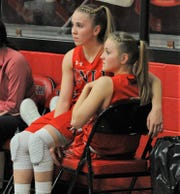 Jim Ned senior Brooke Galvin sits on sister Ashlynn Galvin's lap during a game against Anson on Feb. 11.