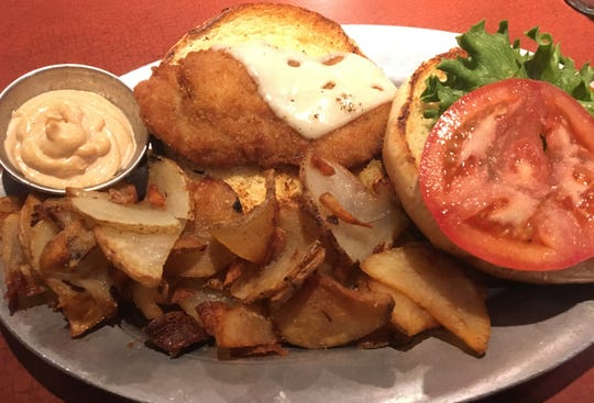The Schnitzel Burger is one of the German-inspired burgers at Territorial Brewing Company, featuring a pork schnitzel.