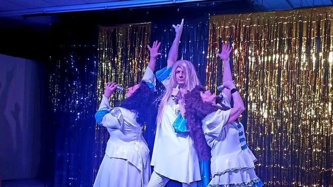 """Nita Wilson (from left), Eli Ghorley and Vicki Richards do Donna and the Dynamos during a """"Mamma Mia!"""" parody."""