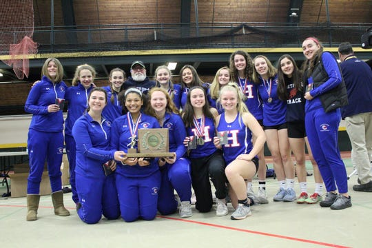 The Hartford girls indoor track and field team poses with the D-II championship trophy on Sunday.