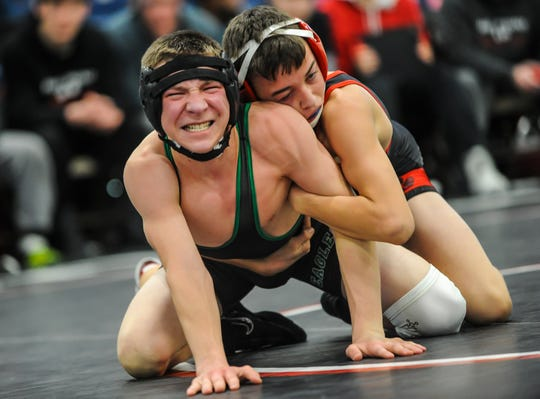 Jacob McDonald of West Deptford, left, grapples with Ryan Mangano of High Point in the 106-pound match in the NJSIAA Team Wrestling Championships Group II at the RWJ BarnabasHealth Arena in Toms River on Feb.16, 2016.