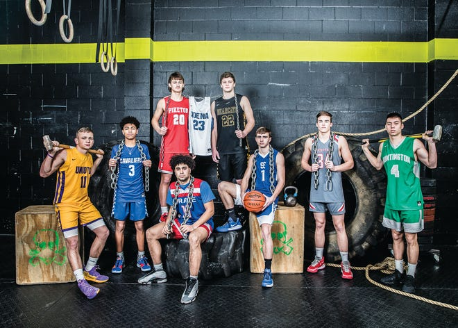 Area boy basketball players are ready to stand strong against their competition this week as the first round of tournament play begins. (L-R) Unioto's Isaac Little, Chillicothe's Tre Beard, Piketon's Chris Chandler, Zane Trace's Cam Evans, Adena's Brandon Smith, Paint Valley's Bryce Newland, Southeastern's Aaron Gillum, Westfall's Luke Blackburn, and Huntington's Seth Beeler.  Photo taken at CrossFit Incognito in Chillicothe.