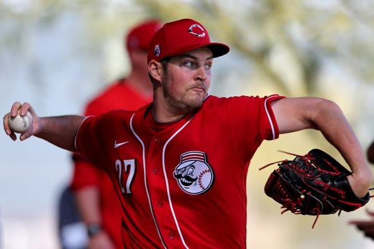Cincinnati Reds starting pitcher Trevor Bauer (27) delivers during a bullpen session, Monday, Feb. 17, 2020, at the baseball team's spring training facility in Goodyear, Ariz.