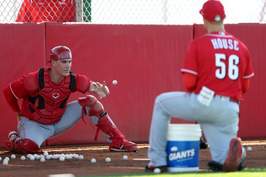 Cincinnati Reds catcher Tyler Stephenson (71) catches a ping-pong ball during drills, Monday, Feb. 17, 2020, at the baseball team's spring training facility in Goodyear, Ariz.
