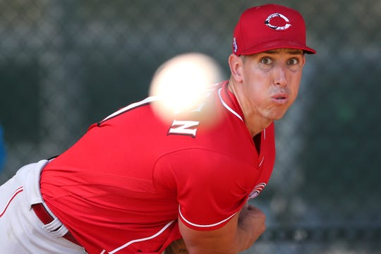 Cincinnati Reds relief pitcher Michael Lorenzen (21) follows through on a delivery during a bullpen session, Monday, Feb. 17, 2020, at the baseball team's spring training facility in Goodyear, Ariz.