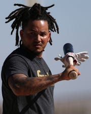 Cincinnati Reds shortstop Freddy Galvis (3) walks to the clubhouse, Monday, Feb. 17, 2020, at the baseball team's spring training facility in Goodyear, Ariz.