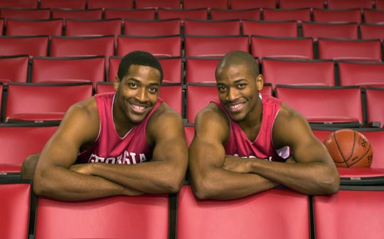 Twins Jonas, left, and Jarvis Hayes pose at the University of Georgia in Athens Oct. 17, 2001. Jonas is now an assistant men's basketball coach at Xavier University and Jarvis is an assistant men's basketball at Georgia State.
