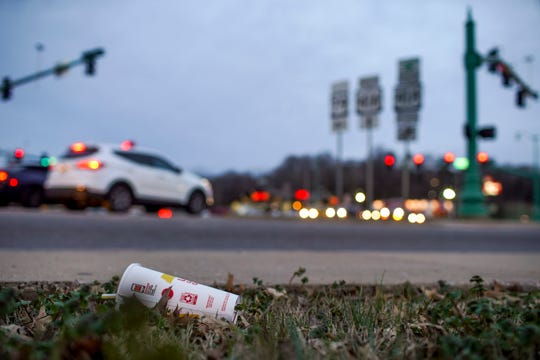 A discarded soda cup is barely hidden in the grass on Providence Blvd in Clarksville, Tenn., on Saturday, Feb. 15, 2020.