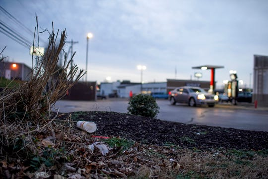 Behind a restaurant litter is strewn about in the bushes on Riverside Drive in Clarksville, Tenn., on Saturday, Feb. 15, 2020.