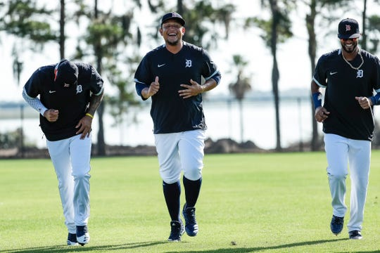Miguel Cabrera, center, talks to infielders Harold Castro, left, and Willi Castro, right, during Detroit Tigers spring training at TigerTown in Lakeland, Fla., Monday, Feb. 17, 2020.