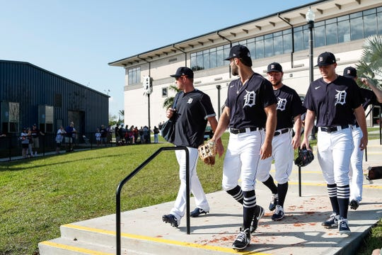 Pitchers Daniel Norris, center, Matthew Boyd, right, and Jordan Zimmermann talk to fans as they make their way to the field for practice during Detroit Tigers spring training at TigerTown in Lakeland, Fla., Monday, Feb. 17, 2020.