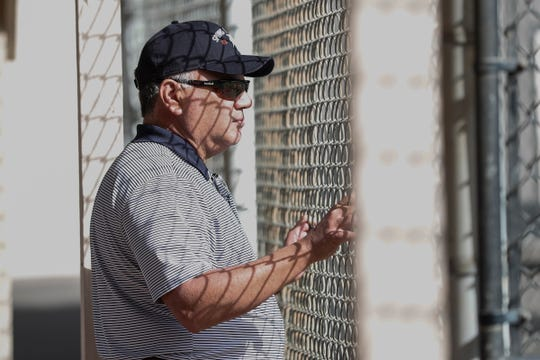 Detroit Tigers general manager Al Avila watches spring training practice at TigerTown in Lakeland, Fla., Sunday, Feb. 16, 2020.