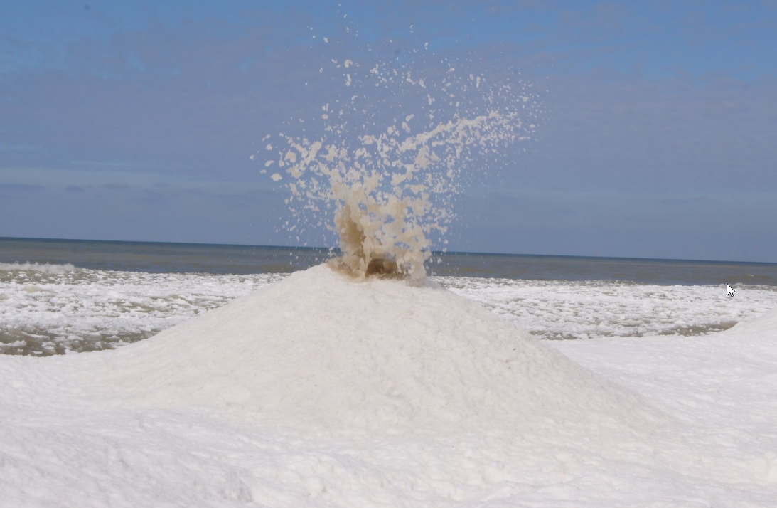 Ice volcanoes  erupt on a Lake Michigan beach. Here s what they look like.