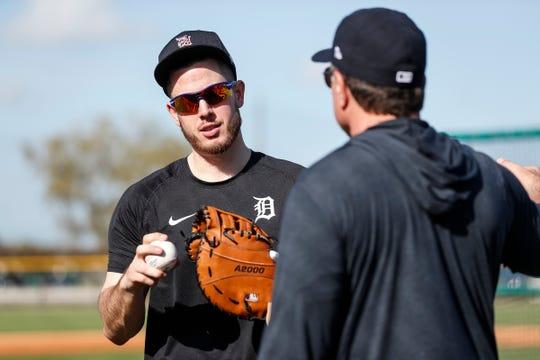 First baseman C.J. Cron talks to coach Lance Parrish during Detroit Tigers spring training at TigerTown in Lakeland, Fla., Sunday, Feb. 16, 2020.
