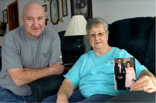 """Linda Ross of Monroe, right, with her son, Randy Ross, left, holds a photo of her parents Charles """"Pap"""" and Virgina """"Mam"""" Rice, who died just two days apart on Feb. 6 and Feb. 8."""