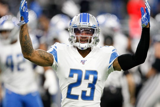Detroit Lions cornerback Darius Slay raises his arms to pump up the crowd after his team recovered a fumble during the first quarter against the Dallas Cowboys at Ford Field, Nov. 17, 2019.