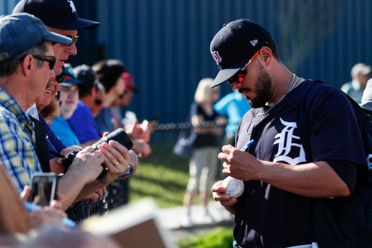 Pitcher Nick Ramirez signs autographs for fans during Detroit Tigers spring training at TigerTown in Lakeland, Fla., Monday, Feb. 17, 2020.