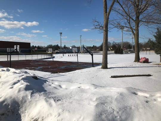 """Behind Birmingham's Seaholm High on Feb. 14, 2020,  athletic fields and tennis courts coexist with snow along with the student body's pink-painted """"spirit rock,"""" awaiting upgrades if a school bond passes on March 10."""