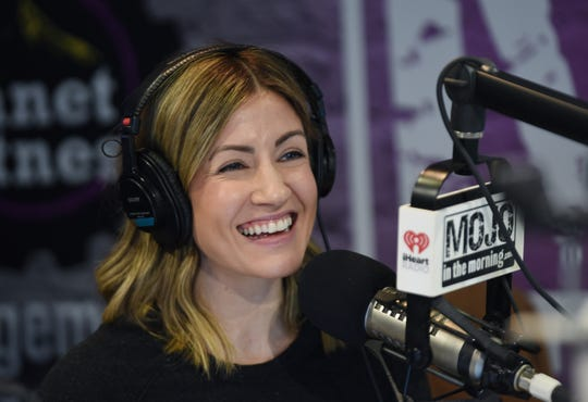 Shannon Murphy, co-host of Mojo in the Morning talks to listeners during the show.