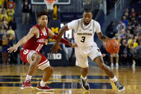 Michigan guard Zavier Simpson drives on Indiana guard Rob Phinisee during the second half Sunday.