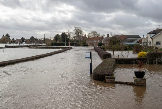 A general view of the aftermath of Storm Dennis in Acaster Malbis, England, Monday, Feb. 17, 2020. Britain issued five severe flood alerts on Monday, warning of a danger to life after Storm Dennis dumped weeks worth of rain in some places.