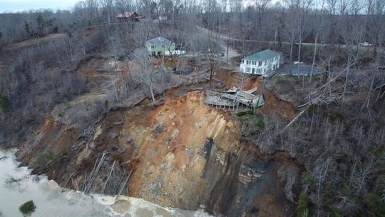 This drone photo provided by Hardin County Fire Department, Savannah, Tenn. on Feb. 15 shows the landslide on Chalk bluff on the Tennessee River.