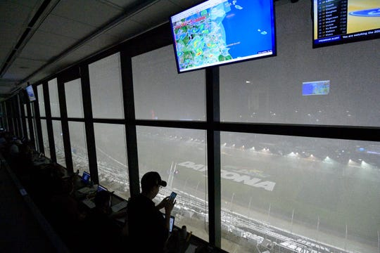 A downpour, as viewed from the press box, forces a postponement of the NASCAR Daytona 500.