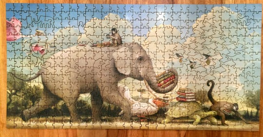 This undated photo provided by Abby Matson shows a jigsaw puzzle she completed. Matson, 37, started a puzzling group with five friends. Jigsaw puzzles are in vogue.