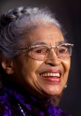 In a June 15, 1999 file photo Rosa Parks smiles during a Capitol Hill ceremony where Parks was honored with the Congressional Gold Medal in Washington.