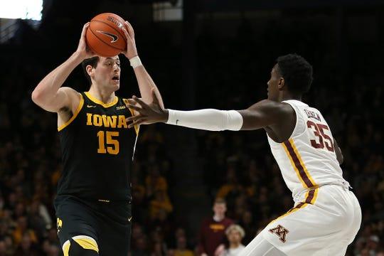 Iowa's Ryan Kriener handles the ball against Minnesota's Isaiah Ihnen.