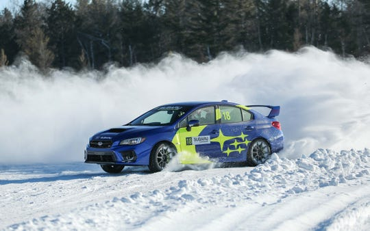 A Subaru WRX STI at full chat across the ice on Wisconsin's Dollar Lake. Though still based on the Impreza's last-gen chassis (new bones should come in 2021), the STI is one of the most capable compact cars on the planet.